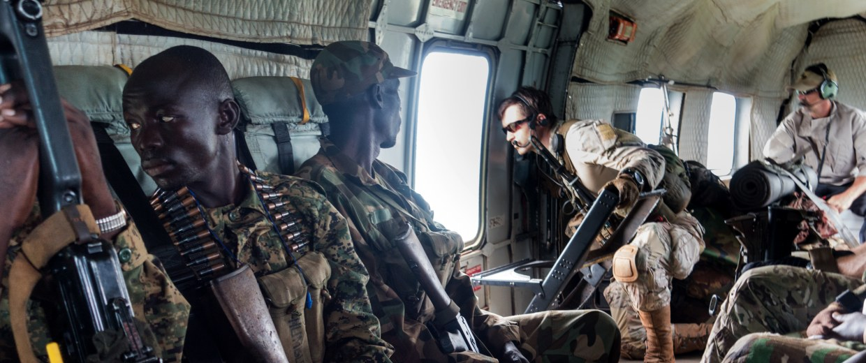 Image: A green beret reconnoiters a landing zone in the wilderness of central Africa