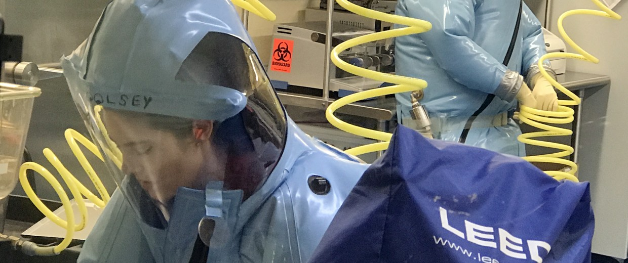 Image: Scientists at the University of Texas Medical Branch work in a specialized, high-security biological containment facility to develop therapies for dangerous pathogens like Marburg and Ravn viruses