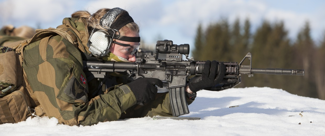 Image: A soldier fires her weapon during a military training exercise at the Terningmoen Camp