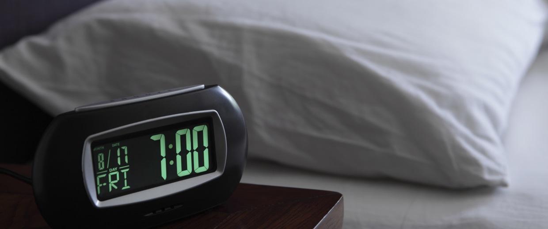 Alarm clock by bed