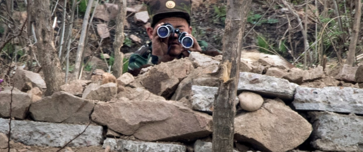 Image: A North Korean soldier near the Yalu River
