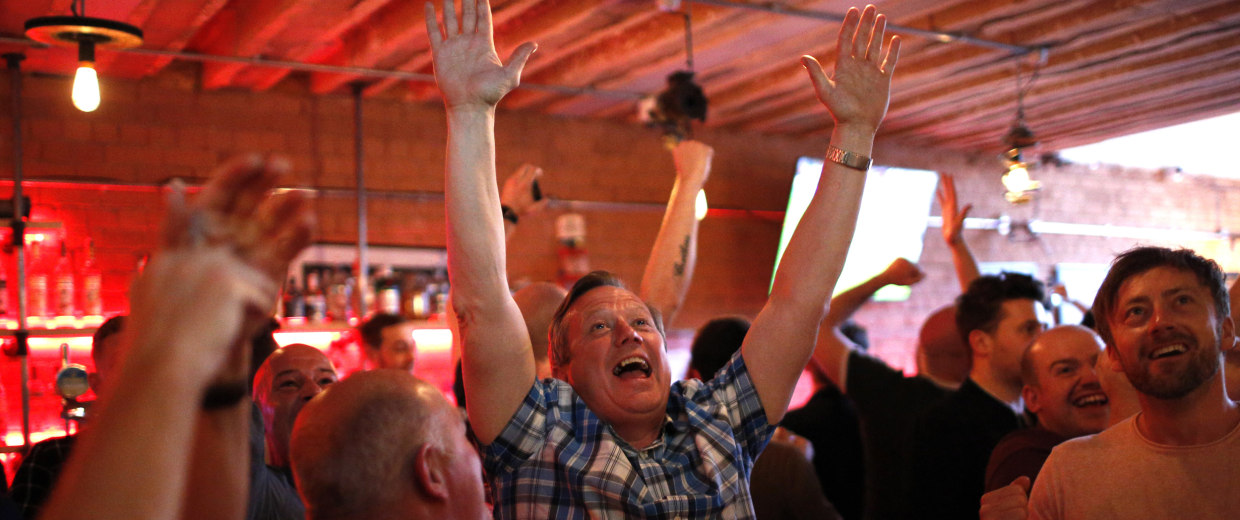 Image: Manchester United fans celebrate the second score of their team during the Europa League final against Ajax Amsterdam in a pub in Manchester