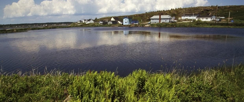 Houses near a pond in Ile Madame, Cape Breton