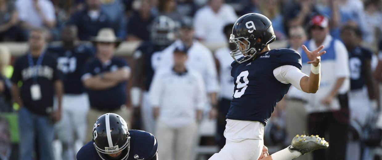 Image: Punter Ryan Nowicki #49 of the Georgia Southern Eagles holds the ball for kicker Younghoe Koo #9, right, during a field goal attempt