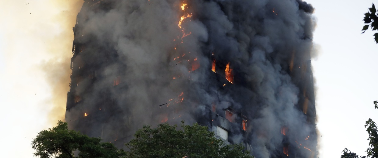 Image: Smoke and flames rise from a building on fire in London