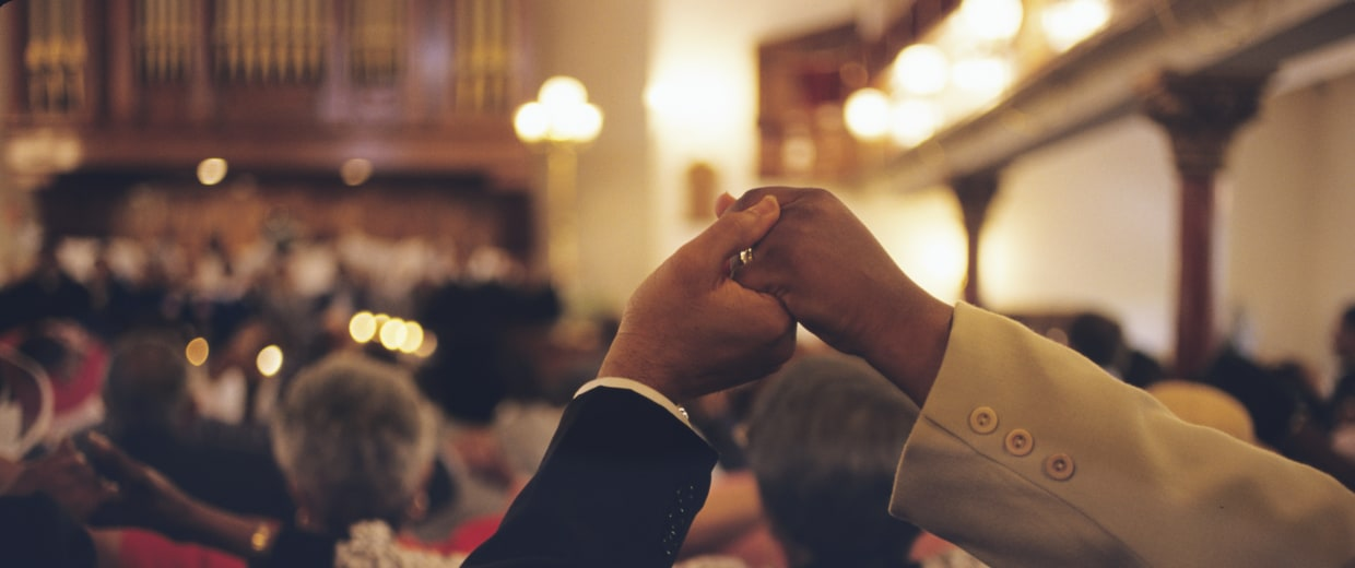 Congregation Holds Hands in Church