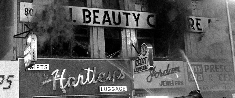 Image: Firemen spray water on burning buildings early July 14, 1967 on Broad Street in Newark, N.J