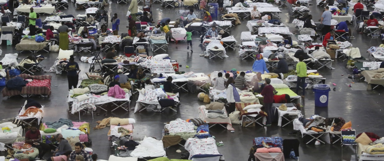 Image: Evacuees escaping the floodwaters from Tropical Storm Harvey rest