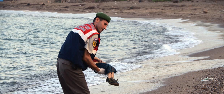 Image: Aylan Kurdi's body is carried on a beach near Bodrum, Turkey