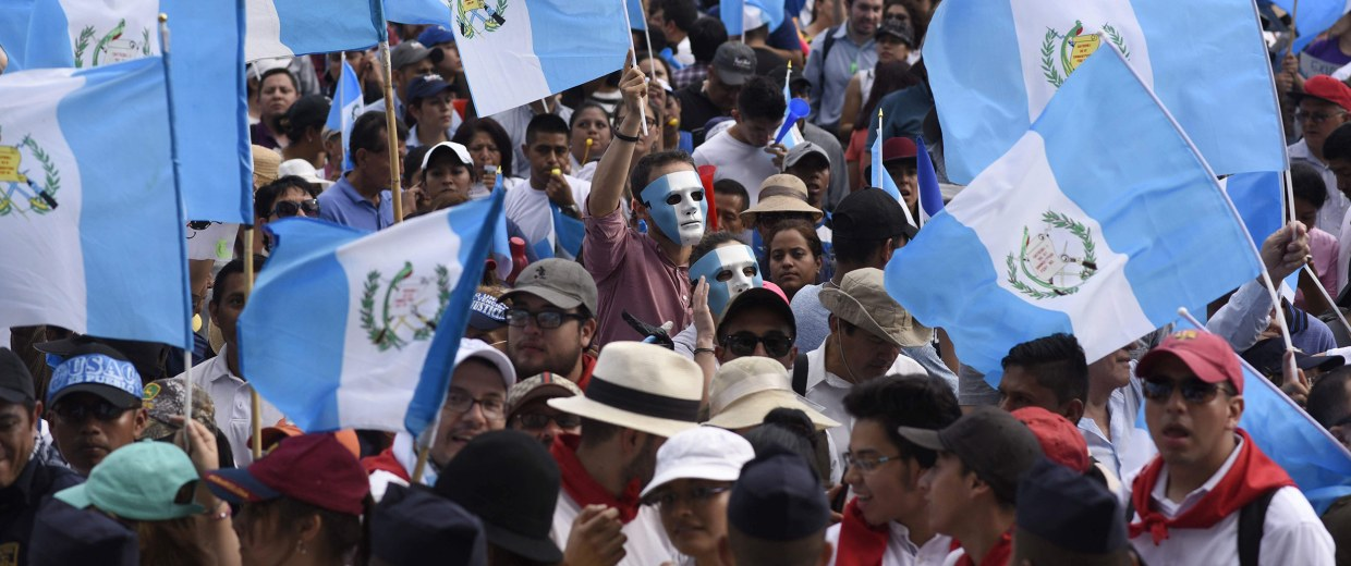 Image: Protesters gather at Constitution Square in front of the National Palace in Guatemala City