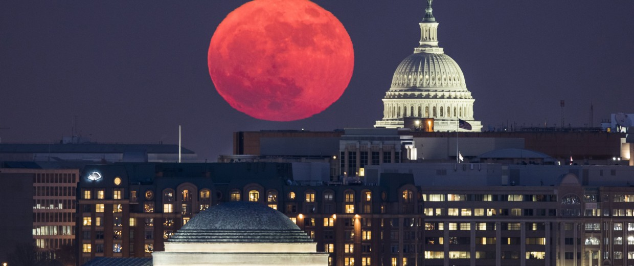 Image: The supermoon rises behind the U.S. Capitol and the Jefferson Memorial in Washington