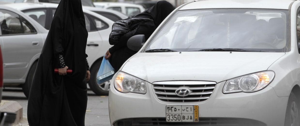 Image: Saudi women board a taxi in Riyadh.