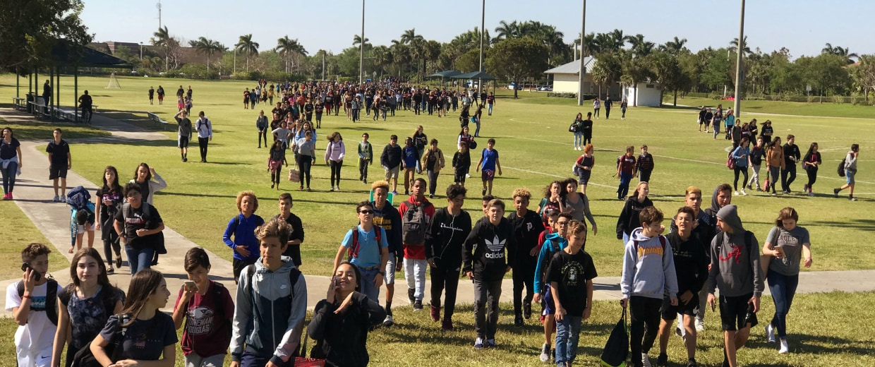 Image: Students from West Lakes Middle School and Marjory Stoneman Douglas High School walkout during a to protest gun violence