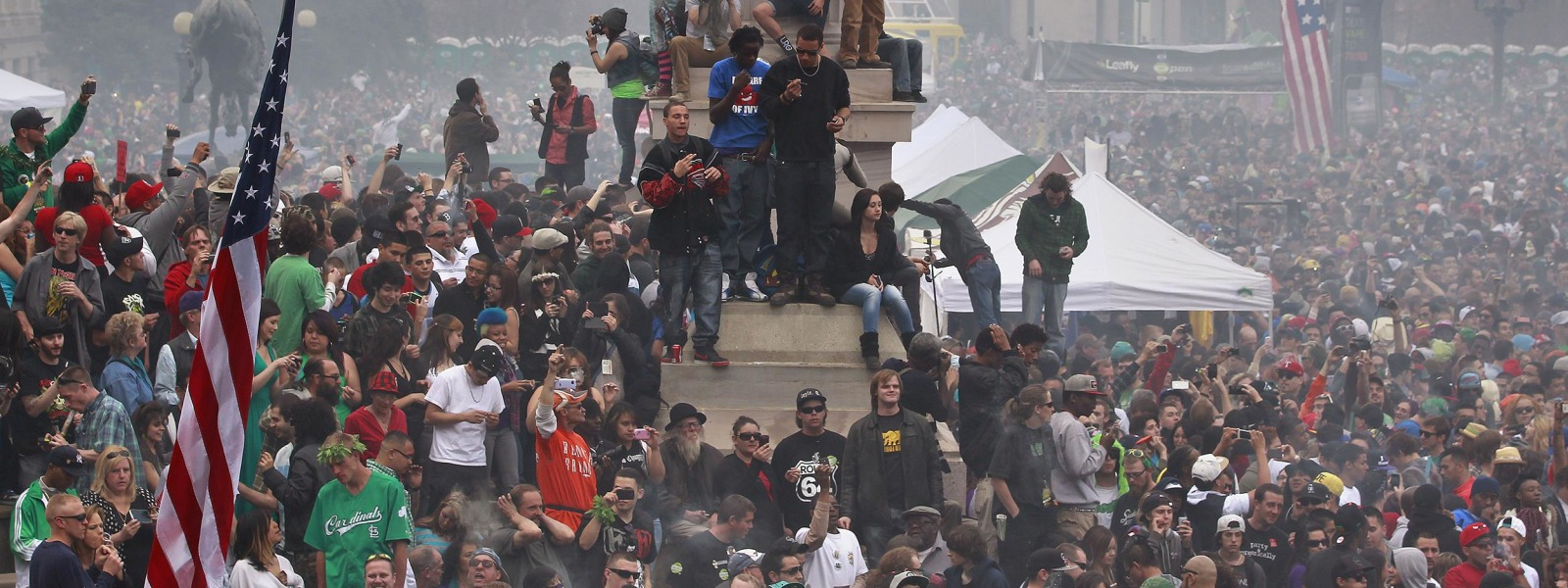 Image: Members of a crowd numbering tens of thousands smoke marijuana and listen to live music, at the Denver 420 pro-marijuana rally in 2013.