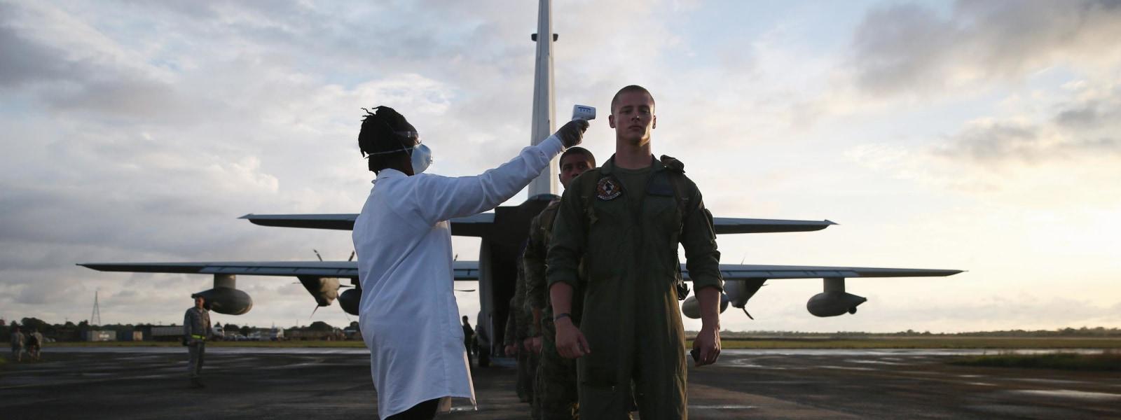 [Image: 141027-marines-liberia-ebola-321p_252d89...00-600.jpg]