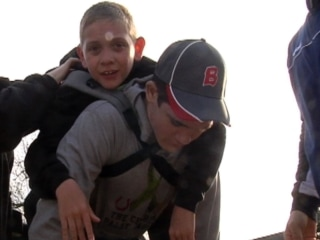 Teen Carries Brother on 111-Mile Awareness Walk