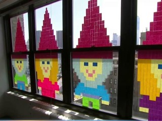 NYC Post-It Battle Takes Over NYC Office Windows