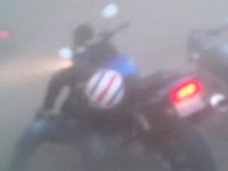 Raw Video: Dust Storm Catches Motorcyclists by Surprise