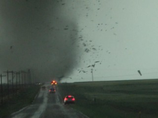 Tornadoes tear through Plains: Flooding, wind - and a tale of survival