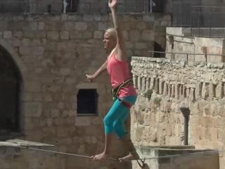 Balancing Act: Woman Walks Slackline Over Jerusalem