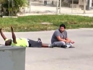 Video Shows Unarmed Caregiver With Hands Up Before Being Shot by Police