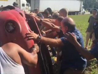 Watch Good Samaritans Overturn Car to Save Man