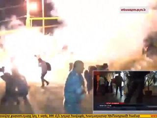Explosions and Tear Gas as Riot Police Clash with Protesters
