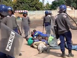 Riot Police Lash Out at Striking Taxi Drivers