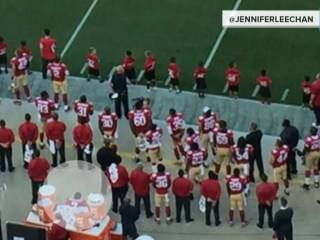 Why didn't NFL quarterback Colin Kaepernick stand for national anthem?