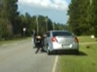 Daschcam Video Shows Car Dragging Cop Down the Road