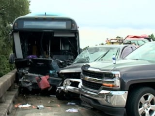 Bus Slams Into Crash Scene, Killing Two