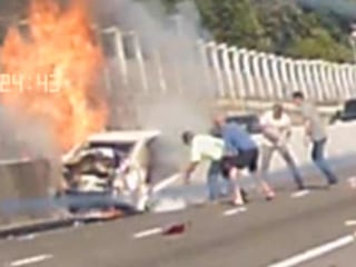 Dashcam video: Bystanders rescue elderly woman from burning car