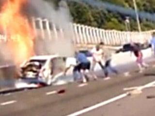 Watch Good Samaritans Rescue Woman From Blazing Car