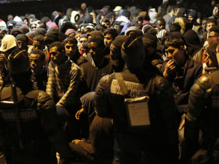 Anxious Migrants Rush 'Jungle' Camp Processing Center