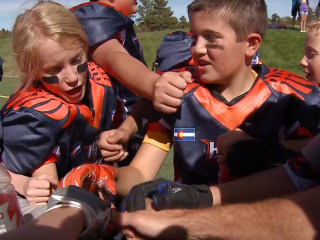 11-Year-Old Girl Pushes Limits on the Football Field