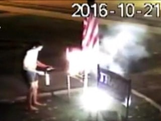 Watch Neighbor Take Blowtorch to Trump Sign