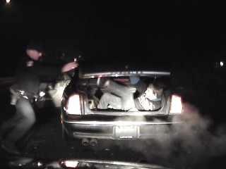 Armed Fugitive Jumps Out of Trunk During Police Stop