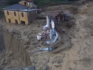 Stream of Mud and Rubble Sweeps Italian Village