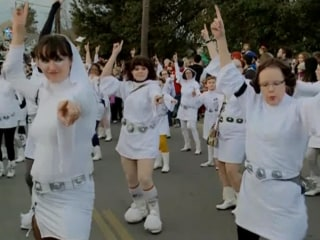 Fans Carry Lightsabers and March in Tribute to Carrie Fisher