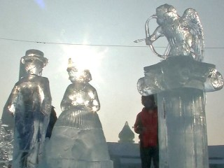 Artists Give Incredible Ice Sculptures Finishing Touches