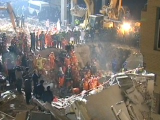 Woman Buried in Collapsed Building Rescued After Phoning Daughter