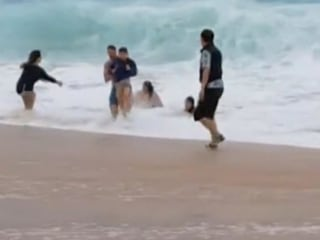 Caught on camera: Dramatic rescue of young boy swept away by wave