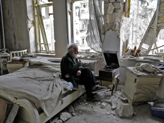 Meet the Man in This Viral Photo From War-Torn Aleppo