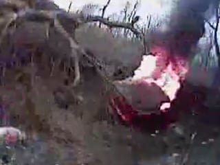 Watch Sheriff's Deputy Rescue Man From Burning Car