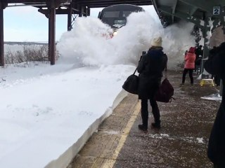 Watch: Incoming Train Blasts Waiting Commuters With Snow