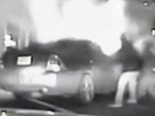 Daring rescue of 2 people from burning car caught on camera