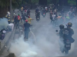 Tear Gas Flows as Riot Police, Protesters Clash in Caracas
