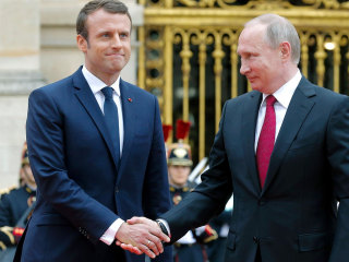 Another Awkward Presidential Handshake: France's Macron Meets Putin