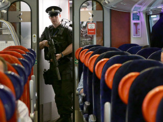 Terror Threat: Rifle-Toting Police Patrol U.K. Trains After Bomb