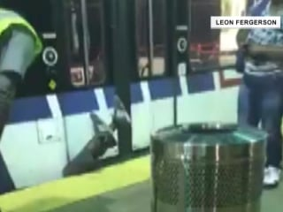Man pinned upside down after slipping head-first between train and platform